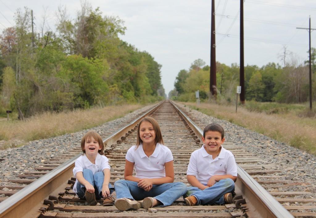 children on train track