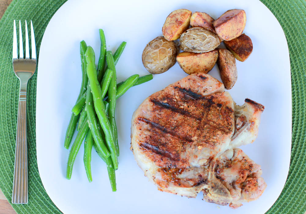 Don't know what to do with a Porterhouse Pork Chop? Make your own steak rub and make the Perfect Grilled Porterhouse Pork Chop!