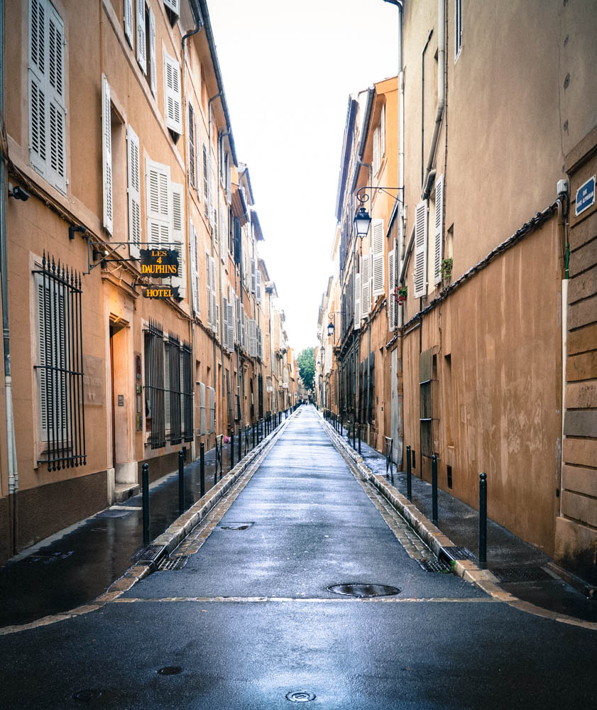 empty street in aix en provence france lined with buildings