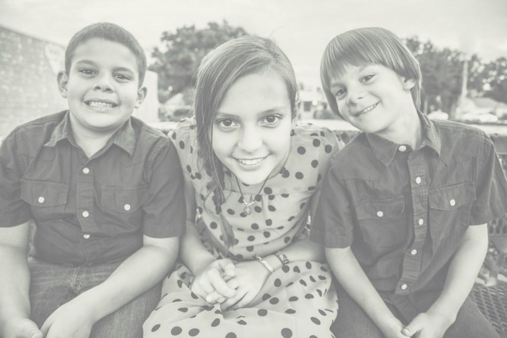 three children on a park bench photo
