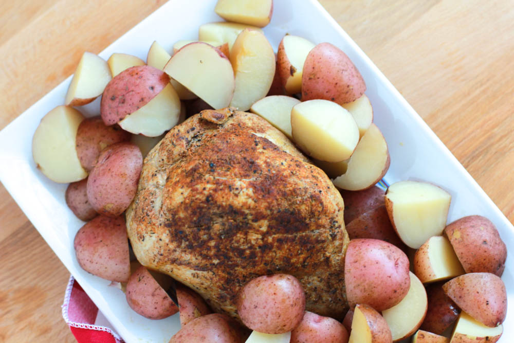 A beautiful array of Slow Cooker Pork Sirloin Tip Roast with Red Potatoes on a plate
