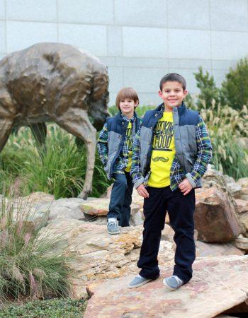 boys on rocks at woodlands waterway