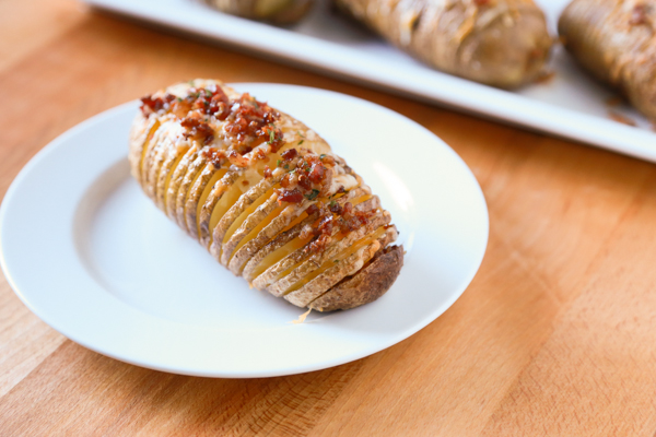 Hasselback Potatoes are a household favorite. Take yours to the next level by adding some bacon and cheese to create these Bacon & Cheese Hasselback Potatoes.