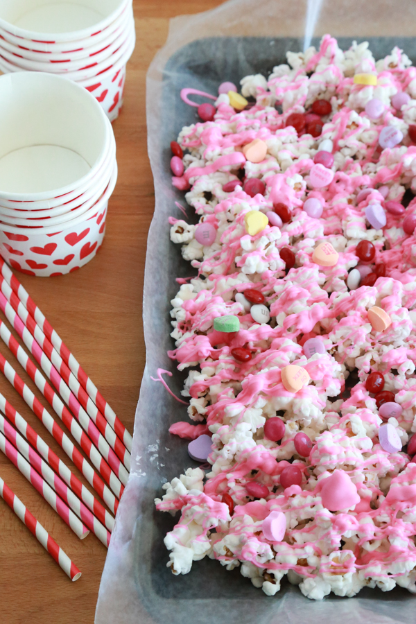 Valentine's Popcorn - an easy Valentine's treat with popcorn, conversation hearts, and M&M's.