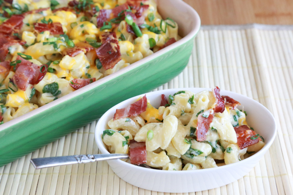 Bacon and Spinach Mac and Cheese. It's as delicious as it sounds. A filling mac and cheese recipe featuring fresh, chopped spinach and crispy bacon.