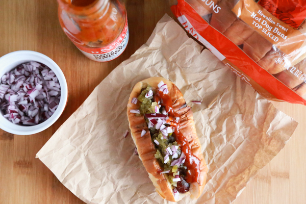 Get ready for your game day parties with these Bacon Wrapped Hot Dogs with pickles and red onion. This ain't your traditional dog recipe!