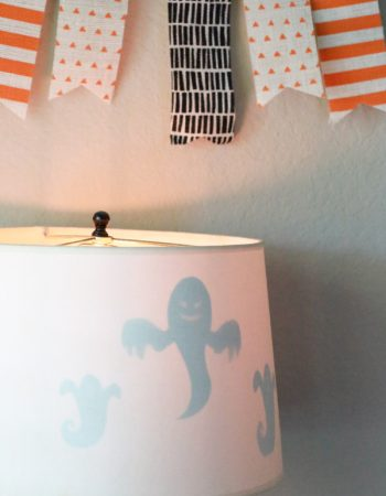 Get the right amount of spooky with this Spooktacular Ghost Lamp Shade. Such a simple way to decorate for Halloween.