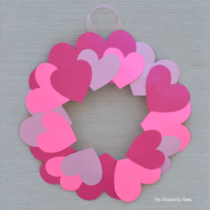 a heart wreath made with many different colored paper hearts