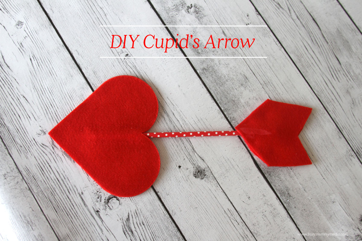 a cupids arrow using felt and a colored straw