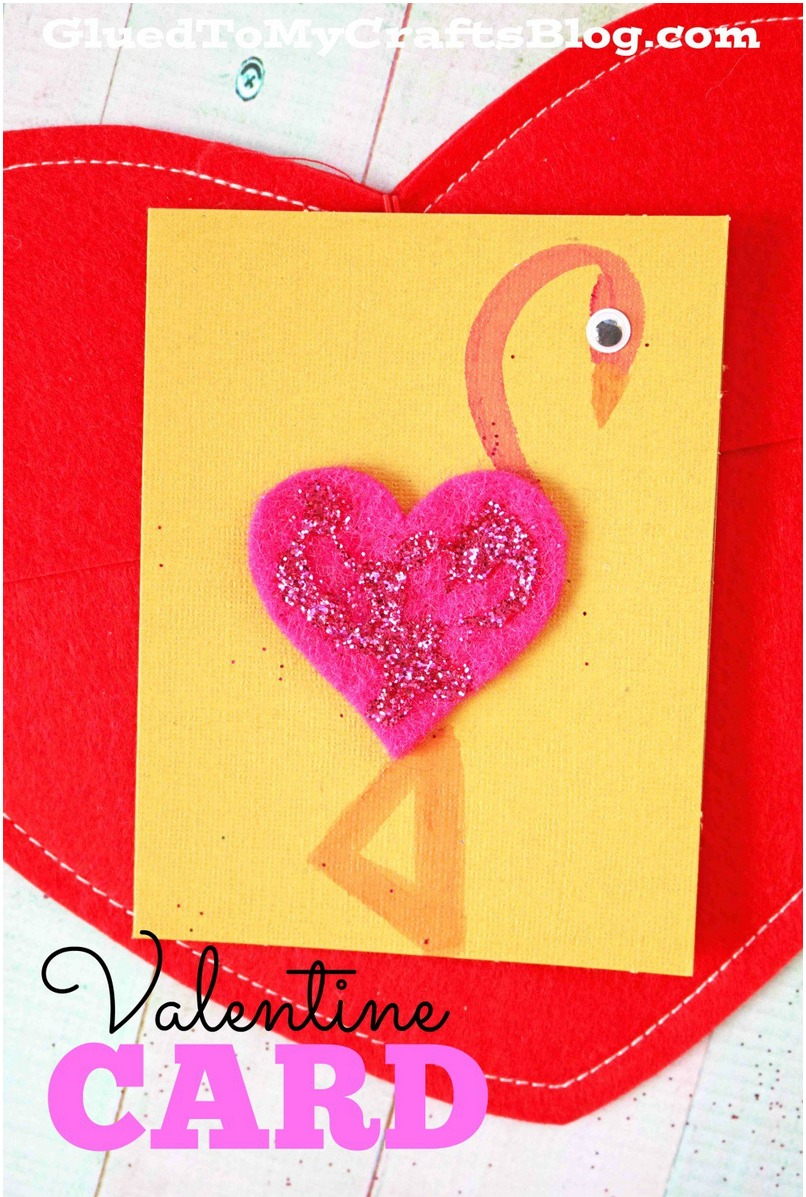 a valentines day card with a homemade flamingo on front made with felt and paint
