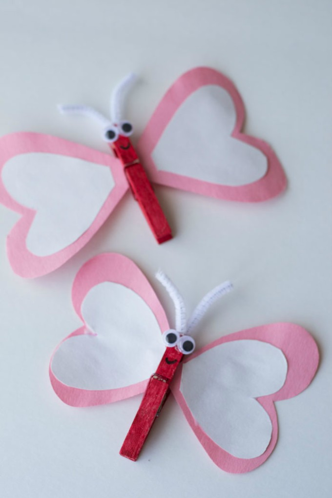 a butterfly made with construction paper hearts with clothespins