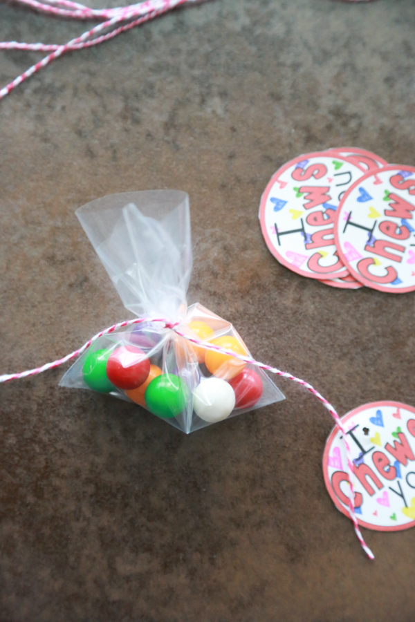 a bag of gum balls with red and white twine wrapped around it
