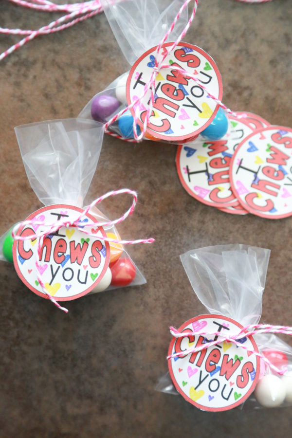 A bunch of bags of gum balls with the I Chews You printable tied on top