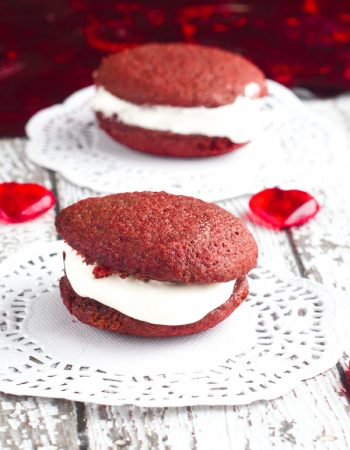 Nothing says Happy Valentine's Day like these Red Velvet Mini Whoopies Pies with Marshmallow Cream Cheese Frosting right in the middle. So yummy!