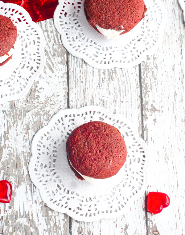 Nothing says Happy Valentine's Day like these Red Velvet Mini Whoopie Pies with Marshmallow Cream Cheese Frosting right in the middle. So yummy!