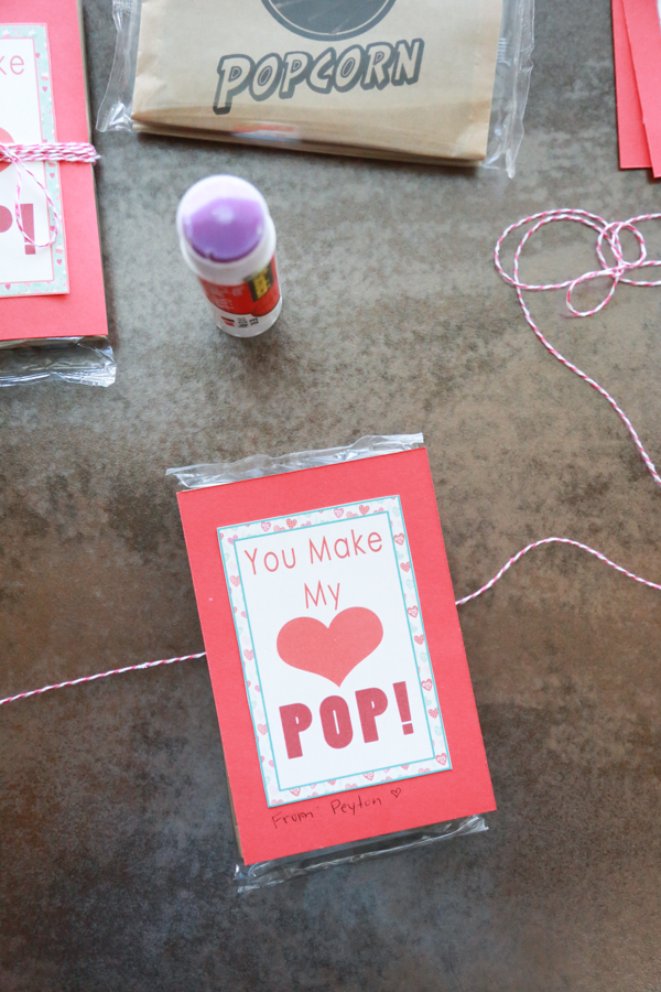 You Make My Heart Pop Valentines printable tied around an unpopped bag of popcorn!