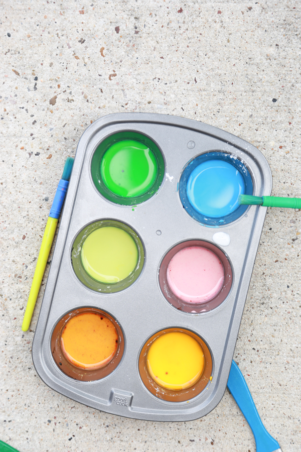 Get the kids outside this summer with this super FUN Homemade Sidewalk Paint. Perfect for toddlers and preschoolers BUT it's fun for ALL AGES! Such a fun, inexpensive DIY for unlimited summer fun.