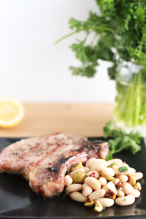 Fire up the grill and make these delicious Grilled Pork Chops with Tuscan Bean Salad.
