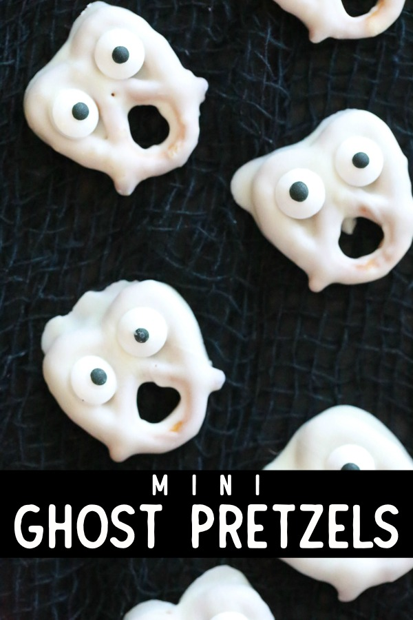 Turn ordinary pretzels into these spooky Mini Ghost Pretzels using just three ingredients. They're so easy to make it's almost scary! #halloween #halloweentreats #ghosts