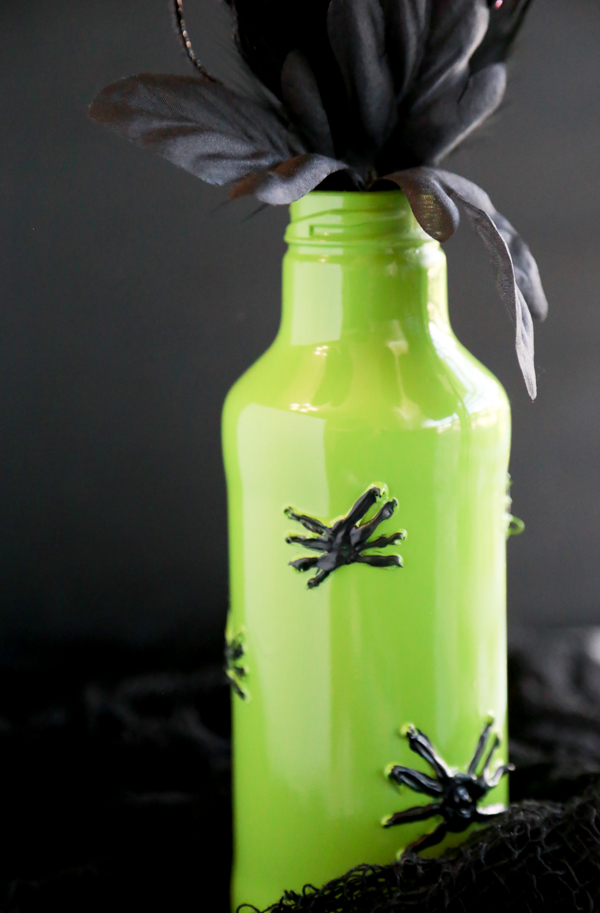 See how you can turn a glass beverage bottle into a spooky Painted Spider Vase for Halloween.