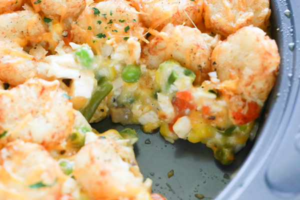 A delicious pan full of Chicken Pot Pie Tater Tot Casserole