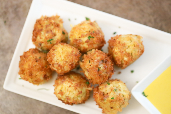 See how you can turn a side of rice into these tasty little Cheddar Broccoli Rice Balls. They're the perfect little appetizer.