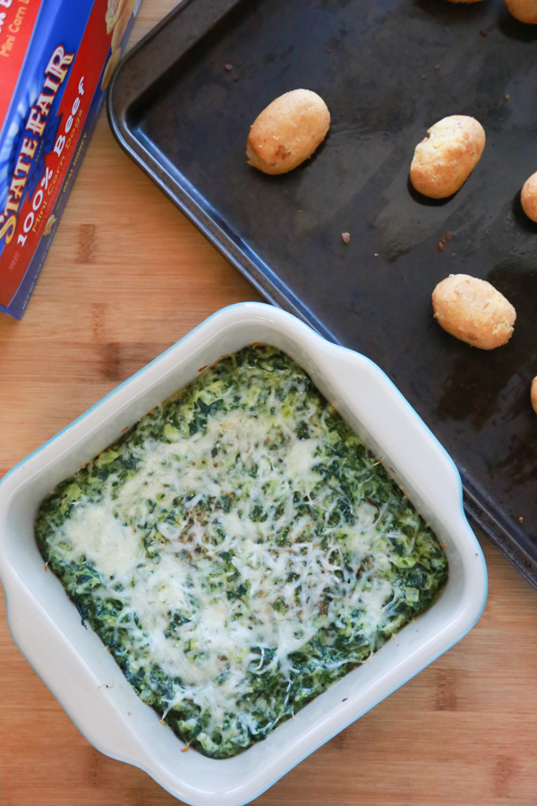Whether you're celebrating the Big Game, National Corn Dog Day, or St. Patrick's Day, this Cheesy Hot Spinach Dip is a great way to kick off the party.