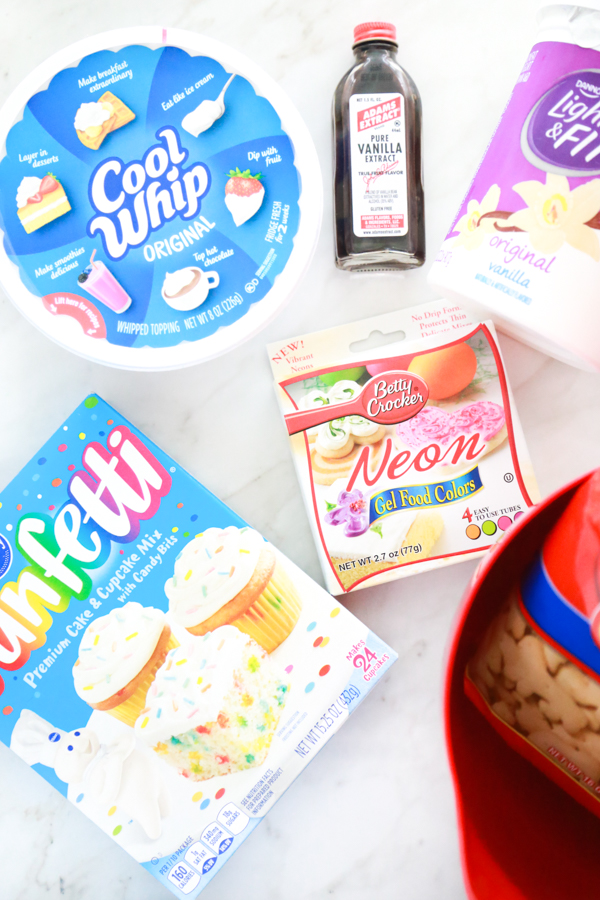 all the ingredients needed to make a colorful batch of Funfetti Rainbow Dip.