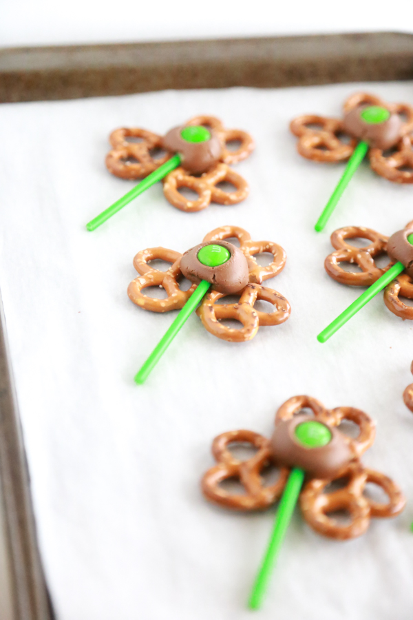 pretzel twists shaped into a shamrock or 3-leaf clover topped with a Rolo chocolate/caramel candy