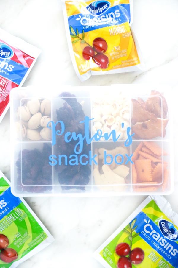 an organizer filled with snacks for an easy on the go snack box