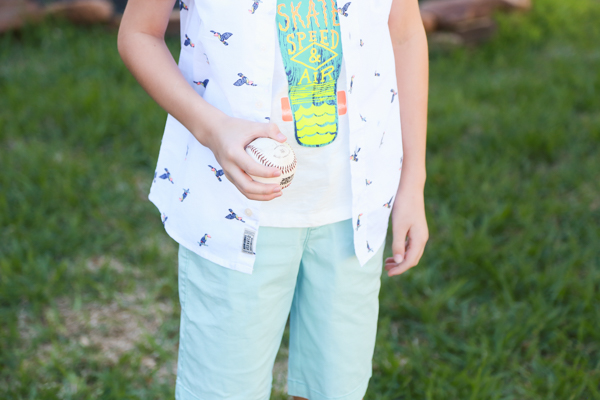 a little boy holding a baseball wearing a spring styles from oshkosh bgosh - perfect spring styles at oshkosh b'gosh