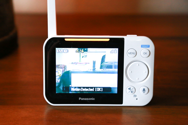 the panasonic long-range baby monitor in use on a wooden table in a home
