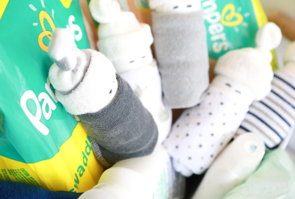 These adorable little DIY Diaper Babies are super cute, easy to make and make the perfect accompaniment to any baby shower gift.