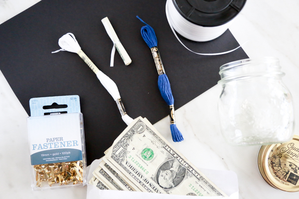 Surprise the deserving graduate in your life with this adorable Mason Jar Graduation Cap Gift Idea filled with dollar bill diplomas. Such an easy and thoughtful graduation gift idea.