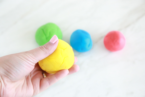 four balls of homemade marshmallow play dough makes a great kids craft and activity