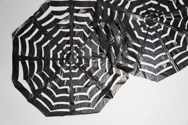 how to make trash bag spider webs